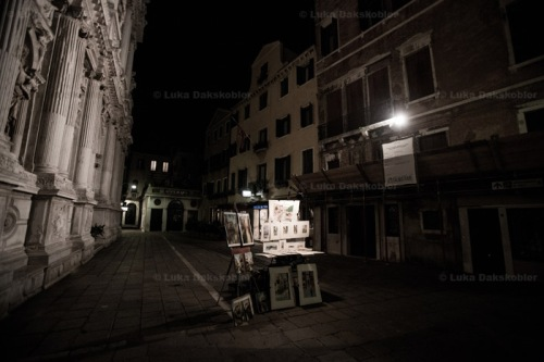 An art stand is seen alone on an empty street in Venice on October 24, 2012