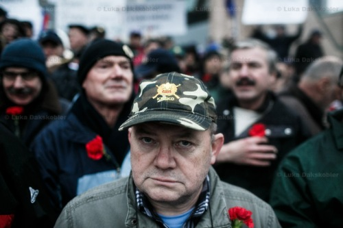 A war veteran wearing a veteran's cap and a carnation protests during a countrywide anti-government protest on December 21 in Ljubljana, Slovenia. Anti-government protest have been organized in Ljubljana, Maribor and other bigger cities in Slovenia since November 2012. The protesters demanded the corrupt political elites to resign, especially prime minister Janez Jansa, following continuous new allegations and even investigation reports of corruption.