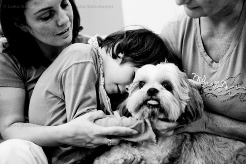 Barbara embraces Sisy during a dog assisted therapy, that strengthens her ability to control her limbs and relaxes her. Dr. Marijan Borstnar rehabilitation institute in Dornava, Slovenia, September 29, 2011. Her love of dogs makes her try harder to embrace or caress the dog, therefore control her movement. But the dog's biggest effect is his ability to relax her completely, stopping spasms and unclutch her fists.