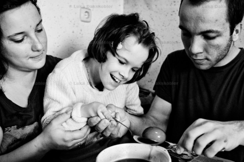 Barbara's sister Petra and brother Andrej help Barbara paint easter eggs in her home during easter holidays, Zavrc, Slovenia, April 7, 2012.
